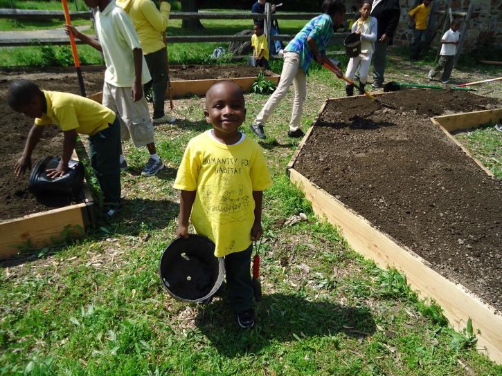 children-volunteers-helping-plant-a-pollinator-garden-725x544